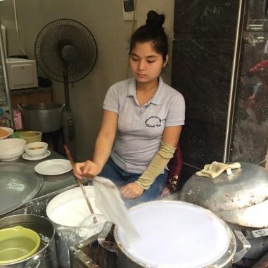 Woman making Banh Cuon at Thanh Van Banh Cuon